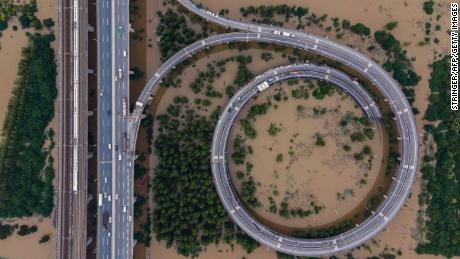 This aerial view shows a bridge leading to the flooded island of Tianxingzhou in Wuhan in central Hubei province of China on July 13.