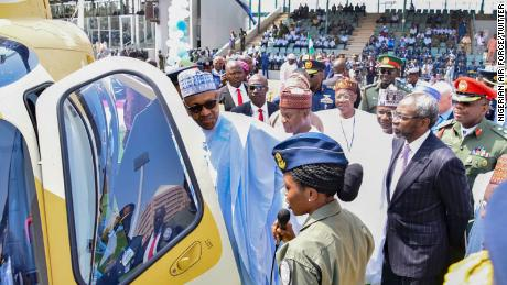 Arotile pictured with President Muhammadu Buhari.