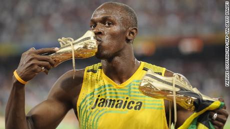 Jamaican Usain Bolt kisses his shoe after winning the men's 100m final at the National Stadium at the 2008 Beijing Olympic Games on August 16, 2008.
