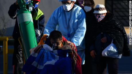A nurse helps a Covid-19 patient outside a hospital in the city of Arequipa, Peru, on July 23, 2020.