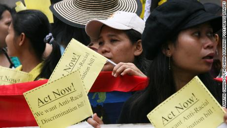 Ethnic minorities protest against racial discrimination in Hong Kong in July 2006, as the government drafts the Race Discrimination Ordinance.
