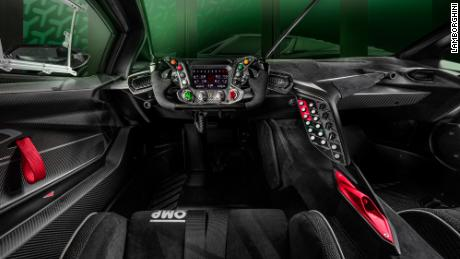 The steering wheel of the Lamborghini Essenza SCV12 is mounted on the Formula 1 racecar steering wheel.