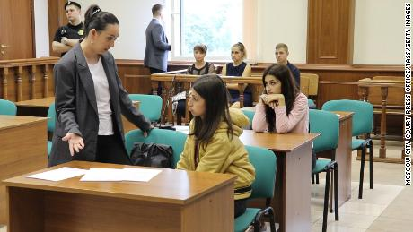 Angelina (center) and Krestina (back), during a hearing at the Basmanny District Court in Moscow.