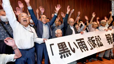 Following the Hiroshima court ruling on July 29, 2020, the plaintiff and a group of supporters celebrate.