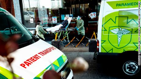 A resident of a care facility is taken to hospital on Tuesday as coronavirus grips Victoria.