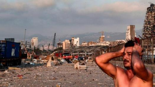 A man reacts at the scene soon after the blast.