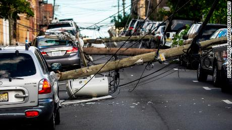 Electricity poles were brought down by Tropical Storm Isaias on Tuesday as it struck Guttenberg, New Jersey.