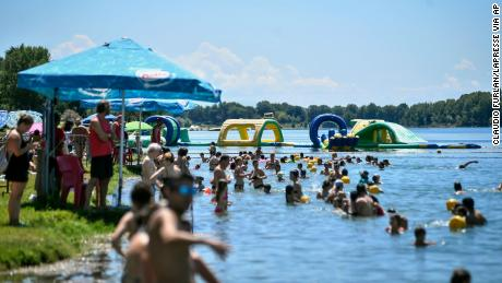 Things are returning to normal in Italy. People swim in an artificial lake in Milan, on July 12.