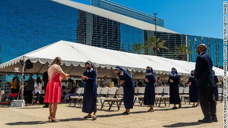 Sisters line up for communion during outdoor mass at Christ Cathedral in Garden Grove, California, on Sunday, July 19, 2020.