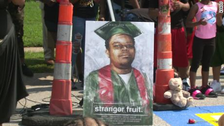 Protesters gather outside Ferguson Police Department on anniversary of Michael Brown's death