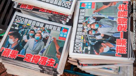 Copies of the Apple Daily newspaper -- paid for by a collection of pro-democracy district councillors -- sit on a cart before being handed out in Hong Kong on August 11, 2020, a day after authorities conducted a search of the newspaper's headquarters after the companys founder Jimmy Lai was arrested under the new National Security Law.