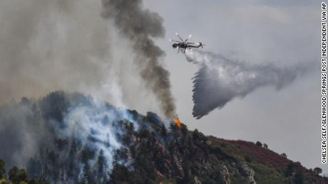 Fire crews work Tuesday to battle the Grizzly Creek Fire as it shoots down the ridge into No Name Canyon.