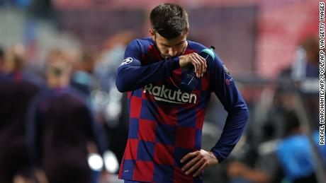 Pique reacts following defeat to Bayern.