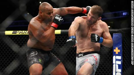Cormier throws a punch at Miocic in the first round during their UFC heavyweight bout in 2019.