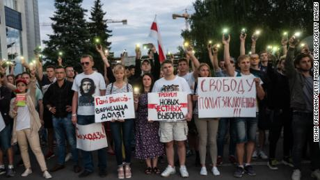 Protesters demonstrate against the results of the presidential election outside the Belarusian state television headquarters in Minsk on August 15, 2020.