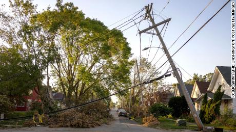 A downed power line leans over a street in Cedar Rapids, Iowa on Sunday, August 16, 2020. A rare Derecho storm battered large sections of Cedar Rapids leaving people homeless and without power.