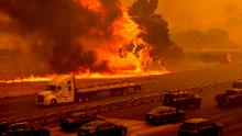 Flames from the LNU Lightning Complex fires jump Interstate 80 in Vacaville, California.