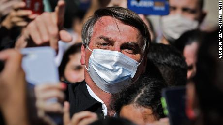 Brazilian President Jair Bolsonaro on Sunday threatened to punch a reporter in the mouth after being asked about his family's links to an alleged corruption scheme.