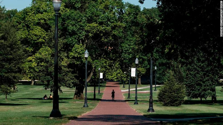 COLUMBUS, OH - AUGUST 13: A lone person makes their way through the 'Oval' at Ohio State University, a part of campus which, during the school year, is popular with students and faculty of the university, on August 13, 2020 in Columbus, Ohio. Incoming students living in the campus dormitories began moving in on the OSU campus on Wednesday. All students moving into the dormitories are required to schedule a time to move in gradually with only 8 students permitted to move into a building in the same hour as an attempt to prevent spread of the coronavirus (COVID-19) among OSU students. (Photo by Matthew Hatcher/Getty Images)
