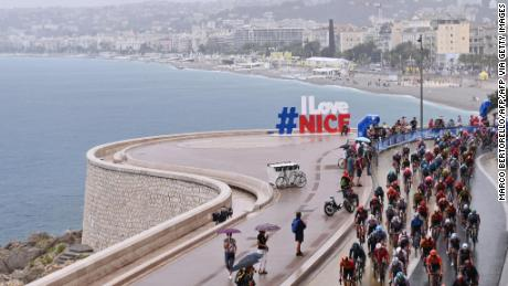 The Tour de France peloton clash on rain-soaked roads in Nice at the start of the 107th Tour de France on a stage littered with crashes in perilous conditions.