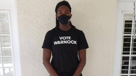 """Elizabeth Williams wearing a """"Vote Warnock"""" shirt. Many members of the Atlanta Dream, as well as players from other teams, have worn the shirts to support Raphael Warnock's US Senate campaign in Georgia."""