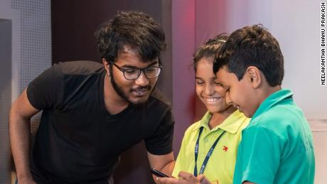 Bhanu does mathematics with two aspiring young mathematicians.