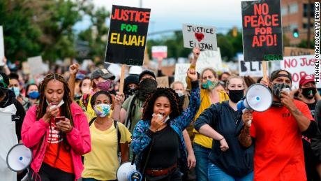 People march in the street to protest the death of Elijah McClain on July 25, 2020, in Aurora, Colorado.