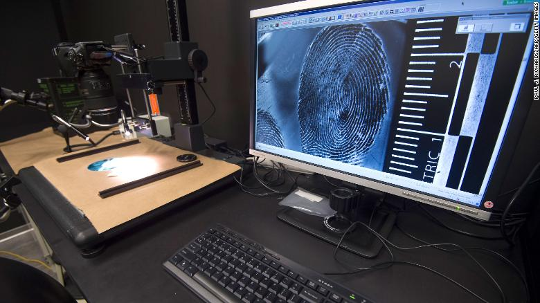 In this July 20, 2016, file photo, a fingerprint is enlarged for examination in the Latent Print Lab at the US Homeland Security Investigation Forensic Laboratory in Tysons Corner, Virginia.