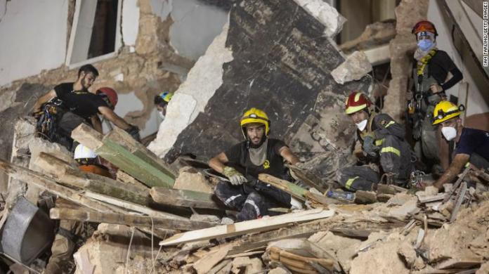 Rescue workers clear rubble from a destroyed building with the aim of finding a potential survivor in the aftermath of the Beirut blast on September 4, 2020 in Beirut, Lebanon.
