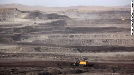 Trucks driving through a coal mine in Huolin Gol, Inner Mongolia on November 15, 2010.