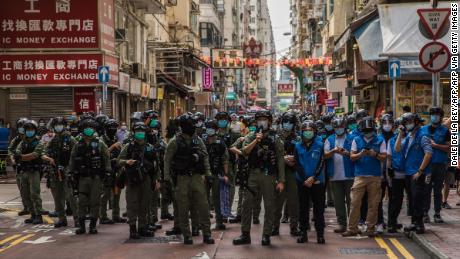 Police patrol an area in Hong Kong after protesters assembled on September 6.
