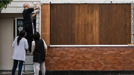 A man barricades his hair salon before Typhoon Haishen approaches in Makurazaki, Kagoshima prefecture on September 5.