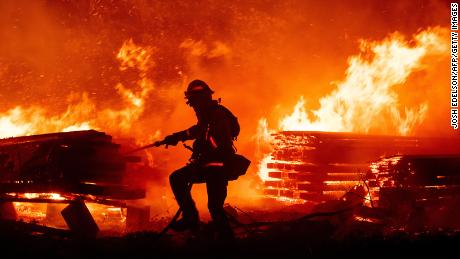 California wildfires have burned more than 2 million acres and prompted power outages for more than 170,000