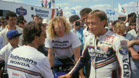Poncharal chats with engineer Guy Coulon (center) and rider Olivier Jacque (right).