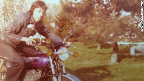 A young Poncharal poses on his Kawasaki Triple 400, near his parents' home south of Paris