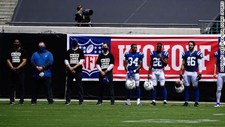 """Indianapolis Colts cornerback Isaiah Rodgers, No. 34, and other teammates stand for """"Lift Every Voice and Sing"""" before the game between the Jacksonville Jaguars and the Colts."""