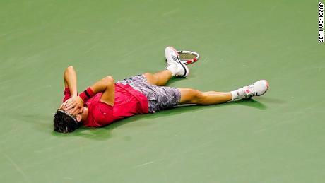 Dominic Thiem slumps to the floor after the winning point.