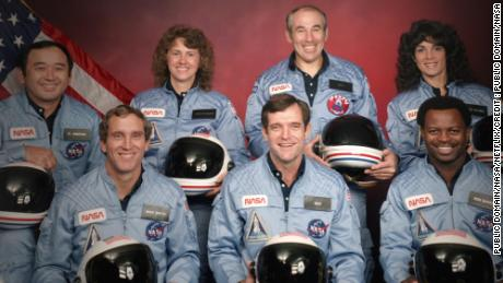 The Challenger 7 flight crew (L to R): Ellison S. Onizuka; Mike Smith; Christa McAuliffe; Dick Scobee; Gregory Jarvis; Judith Resnik; and Ronald McNair (Public Domain/NASA)
