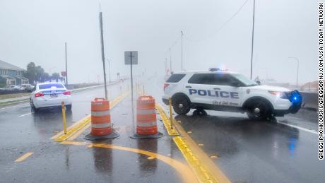 A section of Pensacola's Three Mile Bridge is missing as Hurricane Sally lashes Gulf Coast