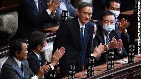 Yoshihide Suga is applauded after he was elected as Japan's prime minister by the Lower House of Parliament in Tokyo on September 16.