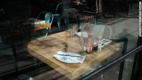 On August 31, 2020, a table in a permanently closed restaurant in Manhattan in New York City is empty.