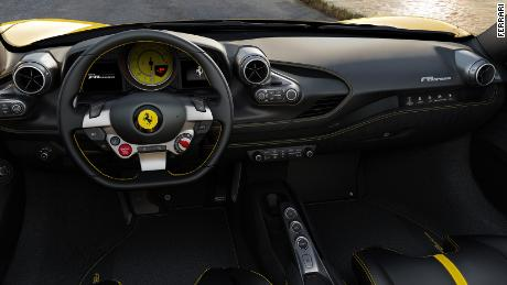 The Ferrari F8's start button is on the steering wheel. For the passenger, there's a narrow touchsreen that can show a speedometer and the engine speed.