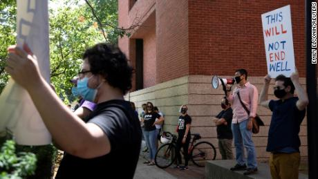 Students and faculty protest in-person class for fall semester amid the coronavirus  pandemic outside of the house of University of Michigan President Mark Schlissel at the University of Michigan.