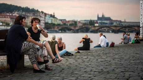 Friends gather at Vltava river bank in Prague, on September 16, as the Czech Republic recorded its highest increase in cases since the beginning of the pandemic.