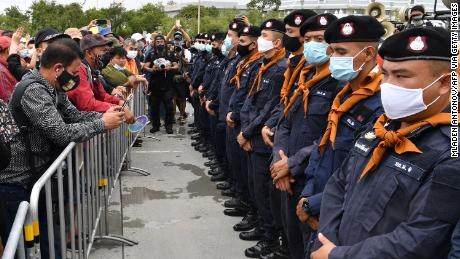 Security forces stand guard as anti-government protesters take part in a rally in Bangkok on September 19.