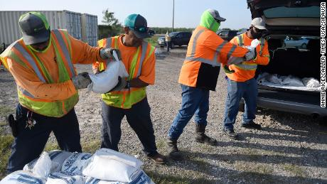 Corpus Christi city workers load free sandbags for residents ahead of Tropical Storm Beta.