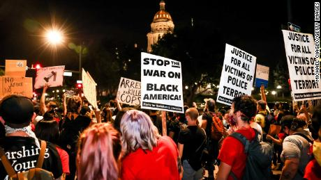 People protest the grand jury decision in the Breonna Taylor case outside  the Colorado State Capitol in Denver on September 23, 2020.