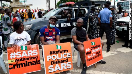 Nigerians take to the streets in mass protests against controversial police unit accused of brutality