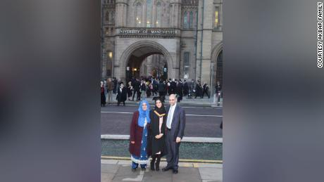 Rabnawaz and Zaida Akbar stand alongside Asma at her university graduation in Manchester, England in December 2016.