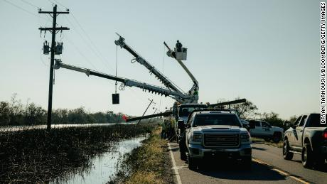 Utility crew work to restore power after Hurricane Delta made landfall in Pecan Island, Louisiana, on Saturday, Oct. 10, 2020.